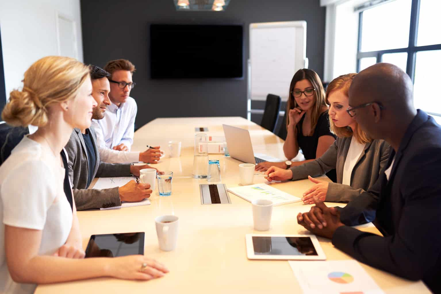 group of executives having meeting in conference room